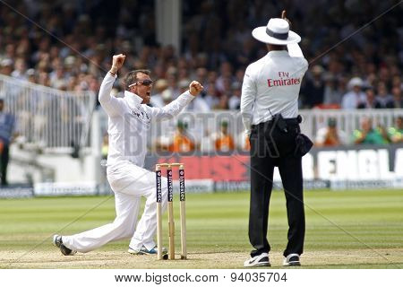 LONDON, ENGLAND - July 21 2013: Graeme Swann appeals for the wicket of Phillip Hughes (not pictured) as umpire Kumar Dharmasena signals out during day four of the Investec Ashes 2nd test match