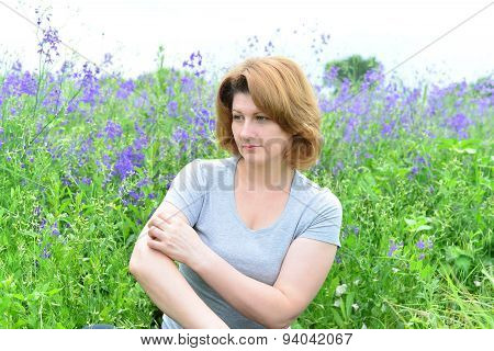 Adult Woman With Neurodermatitis On The Meadow