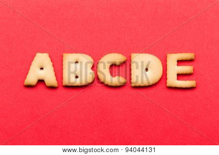 ABCDE cookie over the red background