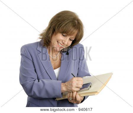 Confident Businesswoman Multitasks