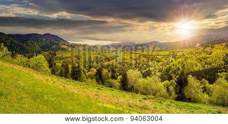 Village On Mountain Slope At Sunset