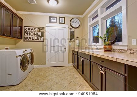 Nice Laundry Room With Tile Floor.