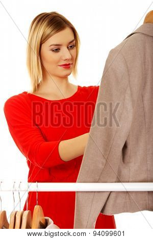 Young woman deciding what to put on. poster