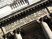 Inscription above the entrance of the Central Criminal Court fondly known as The Old Bailey, which reads 'Defend the children of the poor and punish the wrongdoer' poster