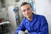 Portrait of smiling young trainee in plumbing sector poster