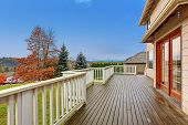 Beautiful large backyard with deck lots of grass annd a view. poster