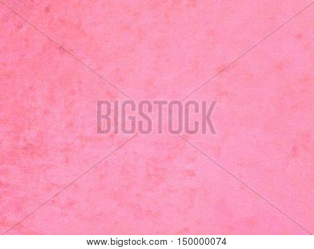 Background with pink texture velvet fabric full frame close-up