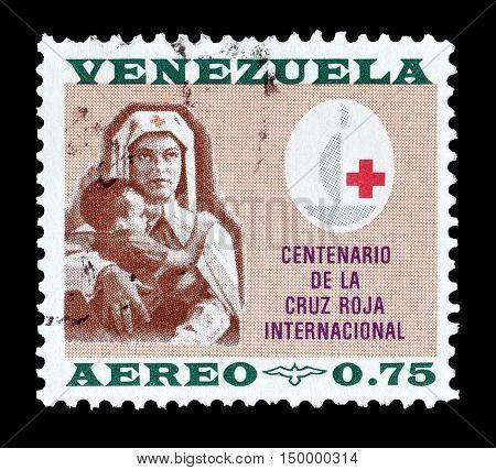 VENEZUELA - CIRCA 1963 : Cancelled postage stamp printed by Venezuela, that shows Nurse holding a child.