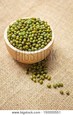 Green bean or mung bean seeds in wood bowl.