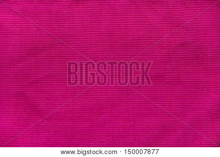 Pink texture of corduroy as textile background.