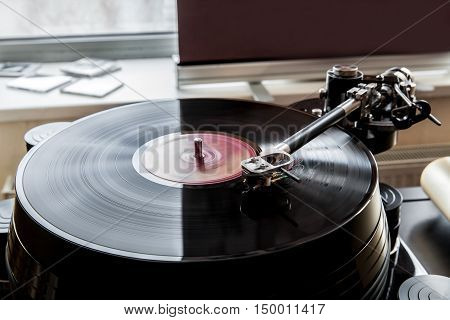 Close up of a record player playing vinyl. Retro Vinyl Turntable Stylus