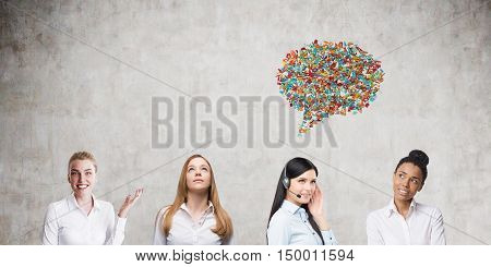 Group of four women standing near concrete wall. Only one of them is speaking. Concept of freedom of speech oppression. Mock up