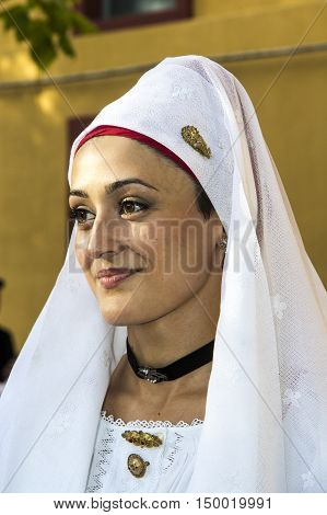 SELARGIUS, ITALY - September 8, 2013: Former marriage Selargino - Sardinia - portrait of a beautiful girl in the folk group Santa Vitalia of Serrenti