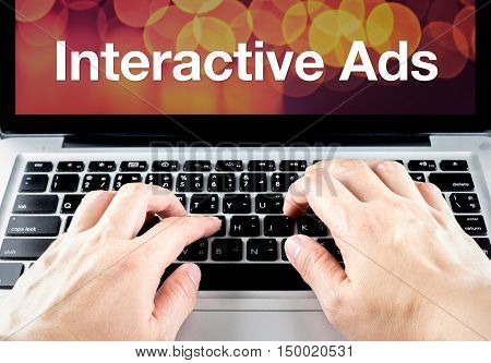 Interactive Ads Word On Laptop Screen With Hand Type On Keyboard, Digital Advertising Concept