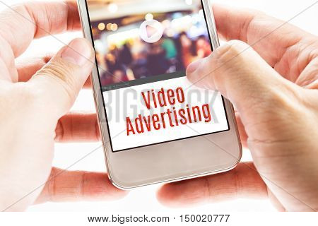 Close Up Two Hand Holding Mobile With Video Advertising Word, Digital Business Concept