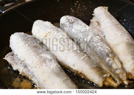 Fried Hake Fish Fillet In A Frying Pan