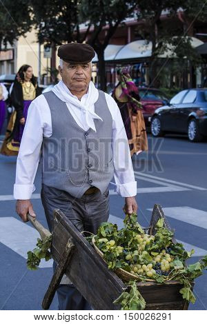 QUARTU S.E., ITALY - September 17, 2016: Parade of Sardinian costumes and floats for the grape festival in honor of the celebration of St. Helena. - Sardinia -ritratto of a man in traditional Sardinian costume