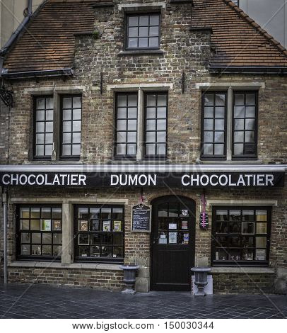 BRUGES, BELGIUM - MAY 12, 2016: Famous for its Belgian chocolate, Dumon Chocolatier is a popular tourist destination.