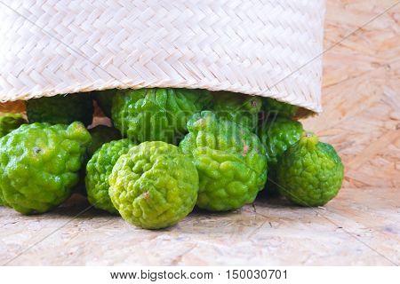 Pile of bergamot (Kaffir Lime) fruit on wood background