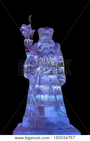 Ice sculpture of Santa Claus isolated on black background