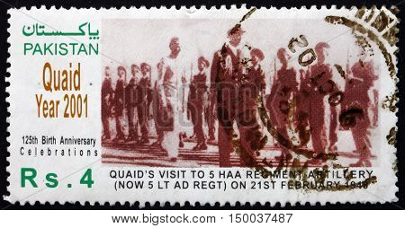 PAKISTAN - CIRCA 2001: a stamp printed in Pakistan shows Mohammed Ali Jinnah Reviewing Troops Quaid Year circa 2001