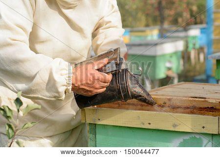 Smoker beekeepers tool to keep bees away from hive. beekeeper tool.