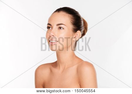 Beauty portrait of a ypung woman with fresh skin looking away isolated on a white background