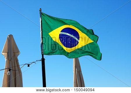 Brazil Flag and blue sky background .
