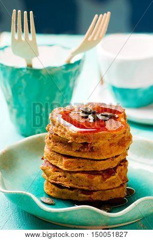 Pumpkin paleo pancakes on blue plate . selective focus
