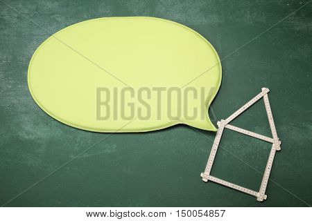 plastic folding ruler to a house shape and speech bubble