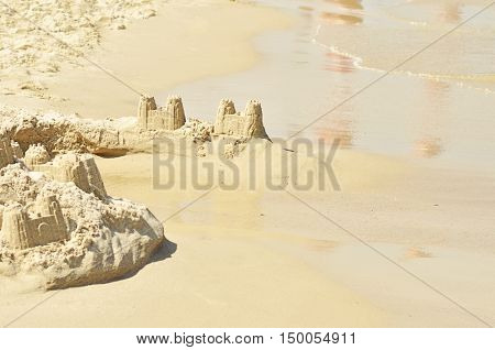 Castle on the beach from sand. Focus in center of image.