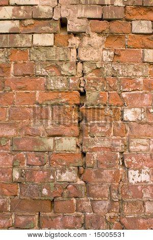 The Damaged Brick Wall.