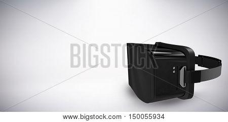 Black virtual reality simulator against white background against grey background