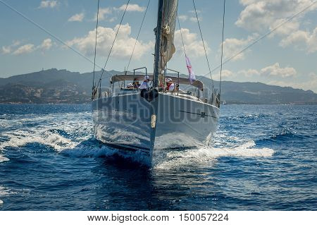 View on the bow of sailing yacht while cruising near Porto Cervo, Sardinia island, Italy.