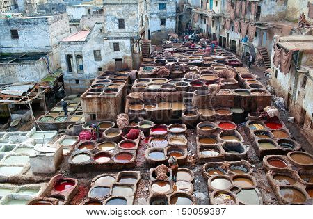 Men Working Hard In The Tannery Souk In Fez, Morocco