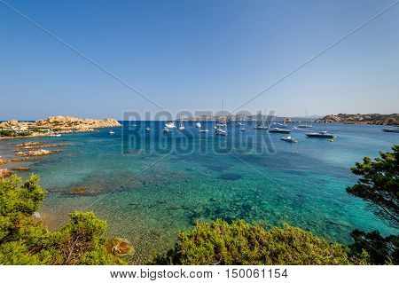 Scenic bay with turquoise water and sailing boat anchorage. Porto Massimo, Sardinia, Italy.