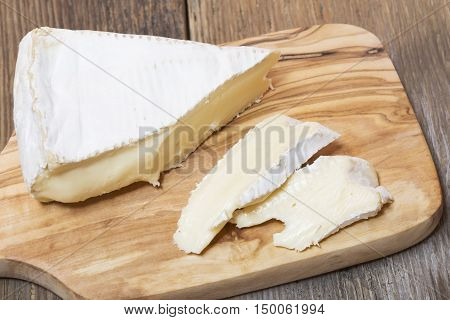 Close up of sliced cheese on wooden board