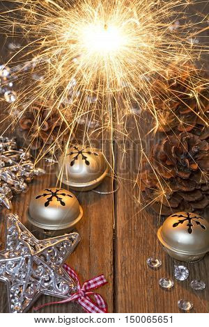 Vintage Christmas decoration with the burning sparkler