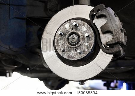 The image of a calliper disk brake close up