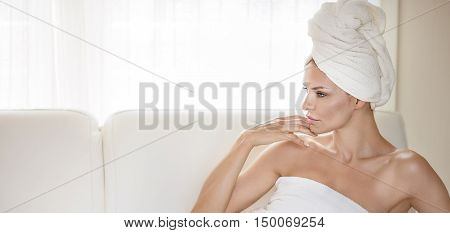 Beautiful Woman Wrapped In Towel.