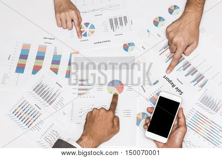 Business people hand pointing at business document in team meeting.