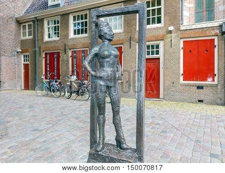 Amsterdam. Netherlands - August 26 2016: Monument prostitute Bella about the oldest church in the red-light district. Amsterdam Netherlands.