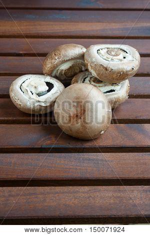 Giant mushrooms Portobello on a wooden table