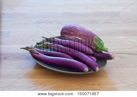 Different sorts of aubergines (eggplants) on the plate