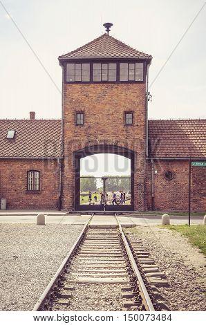 OSWIECIM POLAND - MAY 12 2016: Main gate in Auschwitz Birkenau in Brzezinka Poland.