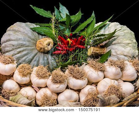 Garlic and other typical autumn vegetables in a basket