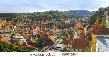 Cityscape of Sighisoara medieval town from the air in autumn season the most beautiful Gothic architecture of Romania