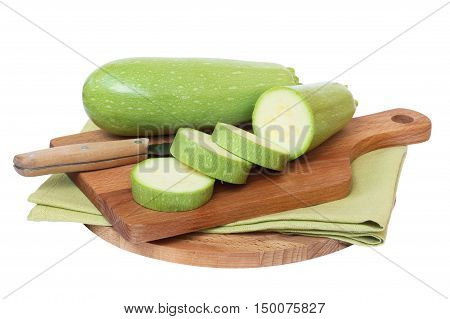 Green zucchini on the board on white background