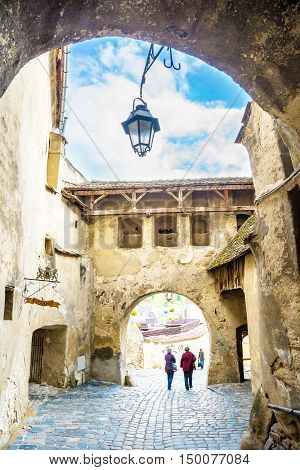 Main gate of the famous citadel in Sighisoara town, entrance of the king