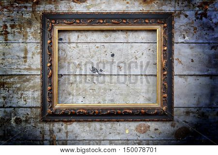 Old blank picture frame on wall